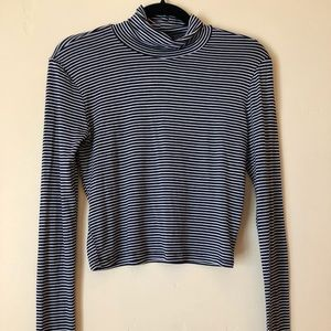 Black and white striped long sleeve turtle neck